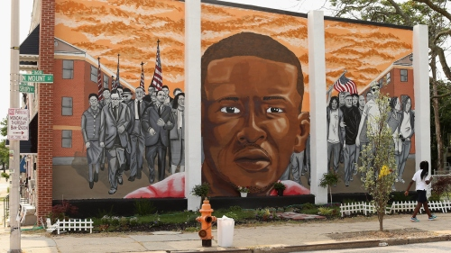 A mural memorializing Baltimore resident Freddie Gray adorns a wall near the place where he was tackled and arrested by police. The Baltimore Sun says it has acquired a copy of the unreleased government autopsy report in the case.
